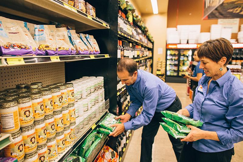 Mark and Stephanie Stocking Shelves