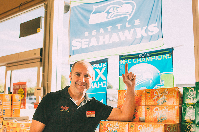 Greg with Seahawks Banner