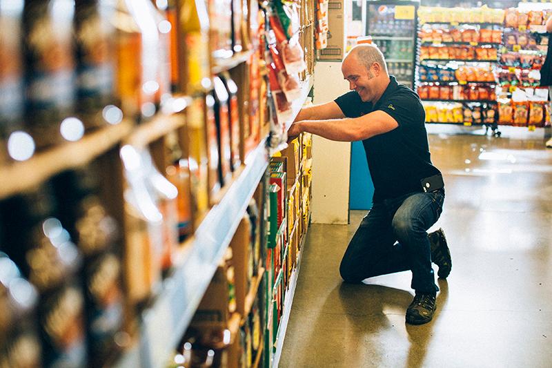 Greg Stocking Shelves
