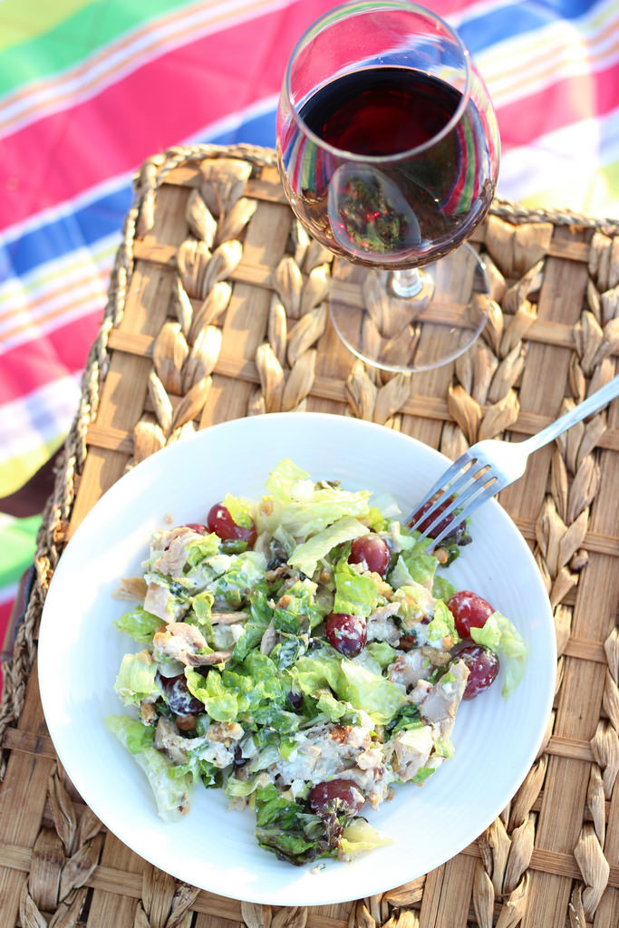 wine on a picnic basket with salad