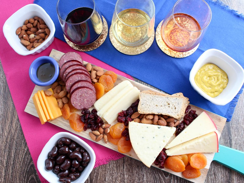 glasses of wine and cheese board