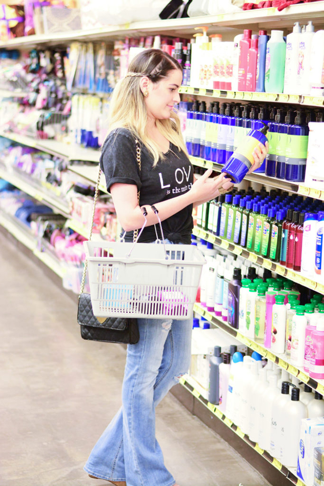 young woman looking at the beauty aisle